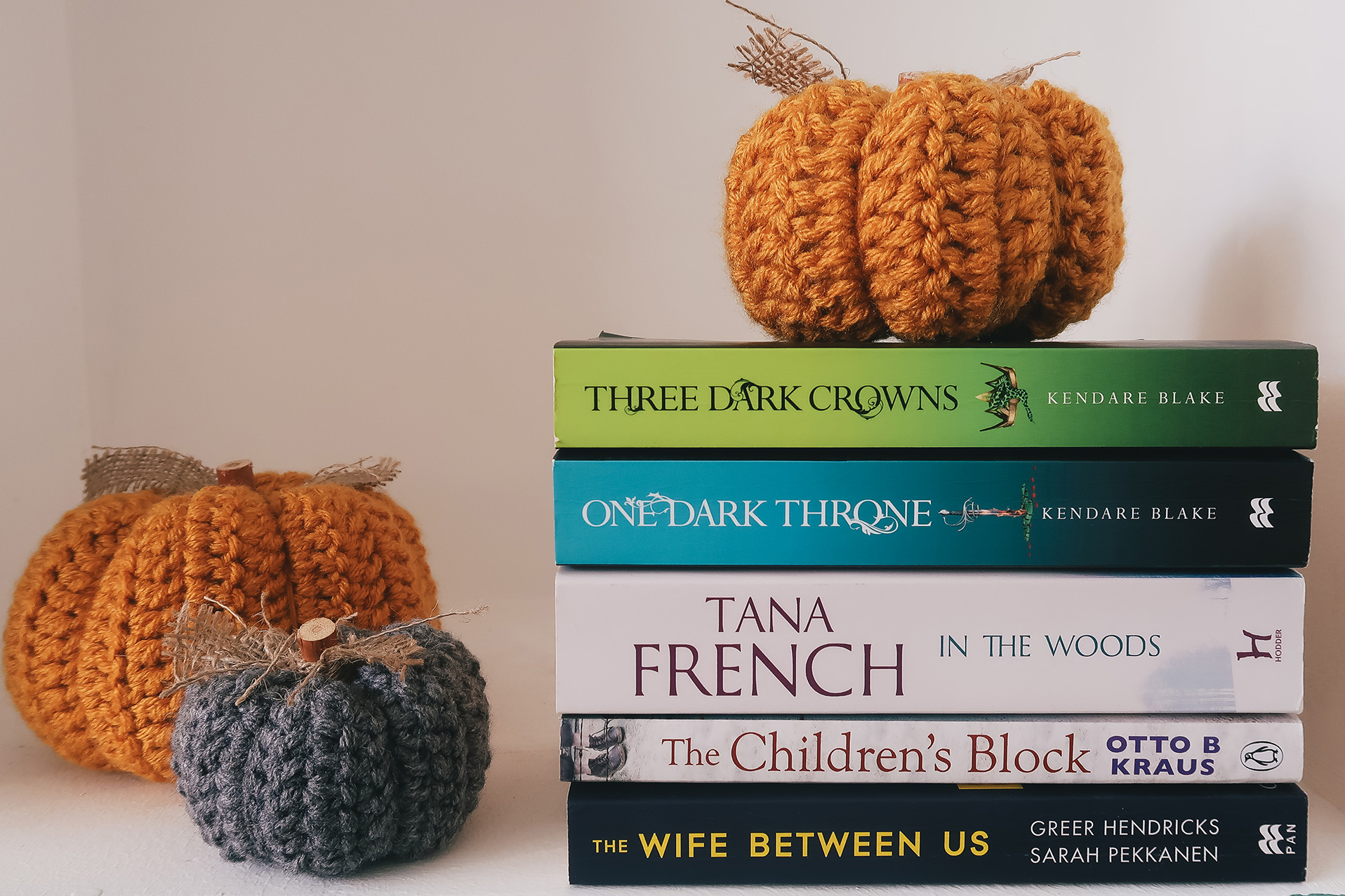 book stack with pumpkins